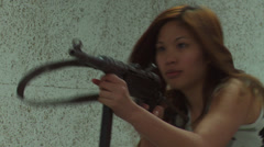 Asian Girl Aiming MP40 - 003 Stock Footage