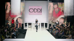 Model in winter clothes walks by podium during ODRI show Stock Footage