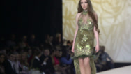 Stock Video Footage of Model in glisten dress walks on podium at Volvo Fashion Week