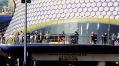 People on the terrace in front of the Bullring Stock Footage