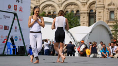 Performance of pair yoga on Red Square. Stock Footage
