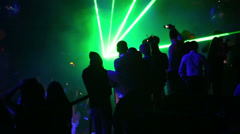 People  in a nightclub with large flashed screen and lasers Stock Footage
