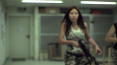 Asian Girl Aiming MP40 - Slow Motion - 006 - stock footage