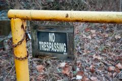 No trespassing yellow gate - stock photo