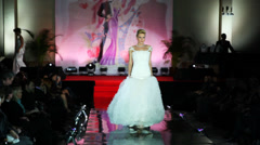 Model in long wedding dress with skirt with corrugated walks catwalk Stock Footage