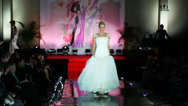 Stock Video Footage of Model in long wedding dress with skirt with corrugated walks catwalk