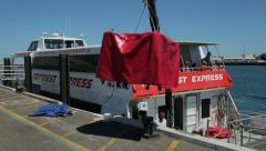 Rottnest express boat, fremantle, luggage being swung aboard, perth, australi Stock Footage
