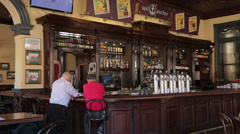 Fremantle, sail and anchor pub, two men at the bar, perth, australia Stock Footage