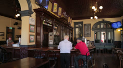 fremantle, sail and anchor pub, two men at the bar, perth, australia - stock footage