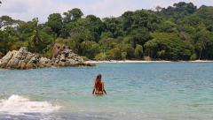 Bikini girl goes for a swim in a tropical paradise Stock Footage