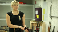 Stock Video Footage of Blonde Girl Aiming AK74 - 001