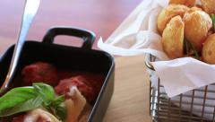 Meatballs with melted cheese and potato wedges Stock Footage