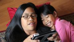 Girl Enjoys Spending Time With Big Sister On Tablet Stock Footage
