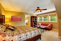 Master bedroom with anitque red couch Stock Photos