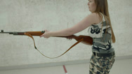 Stock Video Footage of Young Girl Aiming K98 - Side View - 001