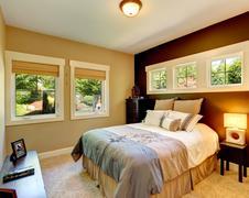 Contrast wall cozy bedroom Stock Photos