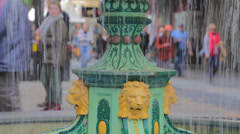 Adelaide downtown - fountain in focus with people walking in the background Stock Footage