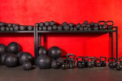 kettlebell  dumbbell and weighted balls at gym - stock photo