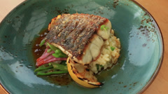 Pan Fried Barramundi Fish dish Stock Footage