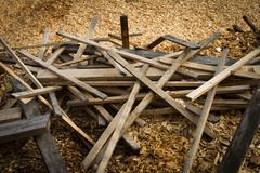Old scrap lumber and wood chips Stock Photos
