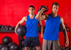 kettlebell and weighted ball workout gym men - stock photo