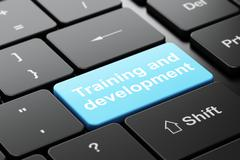 Education concept: Training and Development on computer keyboard background - stock illustration