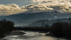 Innsbruck river at the end of winter and mountains time lapse HD Stock Footage