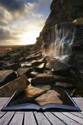 Stock Illustration of book concept beautiful landscape image waterfall flowing into rocks on beach