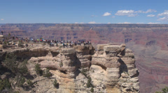 Stock Video Footage of Tourist people visit Grand Canyon USA America sunny destination travel plateau