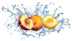 Peach in spray of water. Stock Photos