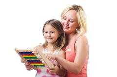 Mother and daughter with abacus on white Stock Photos