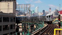 New York City skyline buildings and subway train running Stock Footage