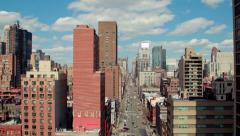 Urban big city buildings street aerial crane dolly moving shot Stock Footage