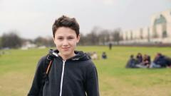 Portrait of young happy teenage student in park HD - stock footage