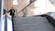 Stock Video Footage of Business Man on Cell Phone on Escalator 4172