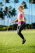 women exercising jumping rope - stock photo