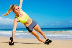 attractive athletic woman doing kettle bell workout - stock photo
