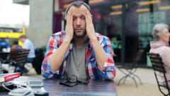Young man having headache in cafe HD Stock Footage