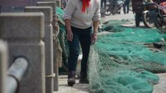 China fishermen repair nets. Stock Footage