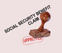social security claim approved stamp - stock photo