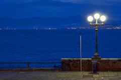 street lamp a bulb  the   sky mediterranean  naples - stock photo