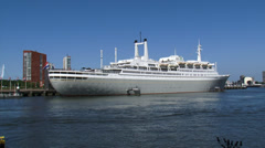 SS Rotterdam moored at Maashaven Rotterdam + pan Nieuwe Maas, Euromast Stock Footage