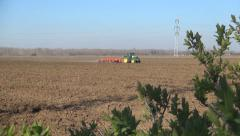 Tractor Plowing Field in Spring, Farmer Working in Agricultural Land, Farming Stock Footage