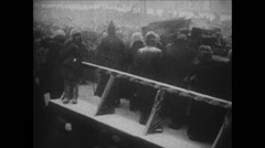 1919 - 1938 Lenin 10 1924 Dead Lenin 07 Masses, coffin and detail on persons - stock footage