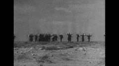 WW2 Africa Soldiers 01 Formations of Prisoners Walk Trough Dessert 01 Stock Footage