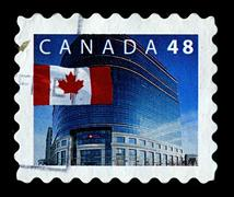 Canada-circa 2002:a stamp printed in canada shows image of the national flag  Stock Photos
