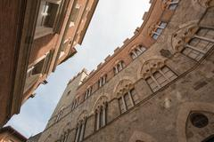 Ancient Medieval Buildings Walls of Siena, Italy - stock photo