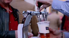 Beer festival, bartender pouring draft beer, outdoors, drinking alcohol - stock footage