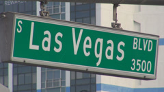 Las Vegas street sign strip indicator road avenue sin city famous party casino  Stock Footage