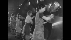 WW2 British Civil Life 09 Women in industrial production, machinery with details - stock footage